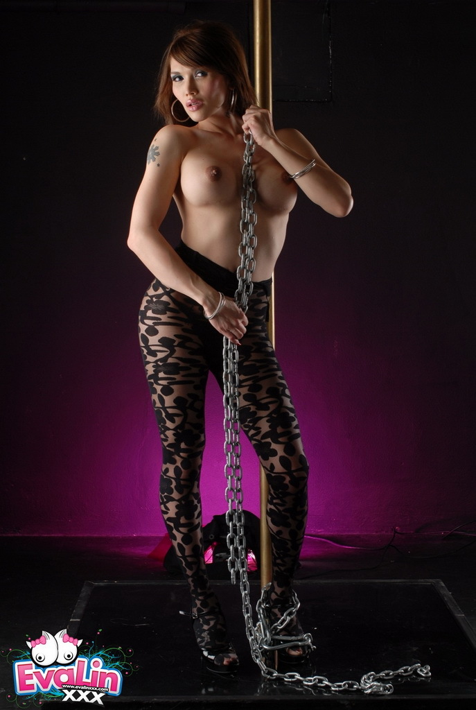 Nasty TS Eva Chained On The Pole