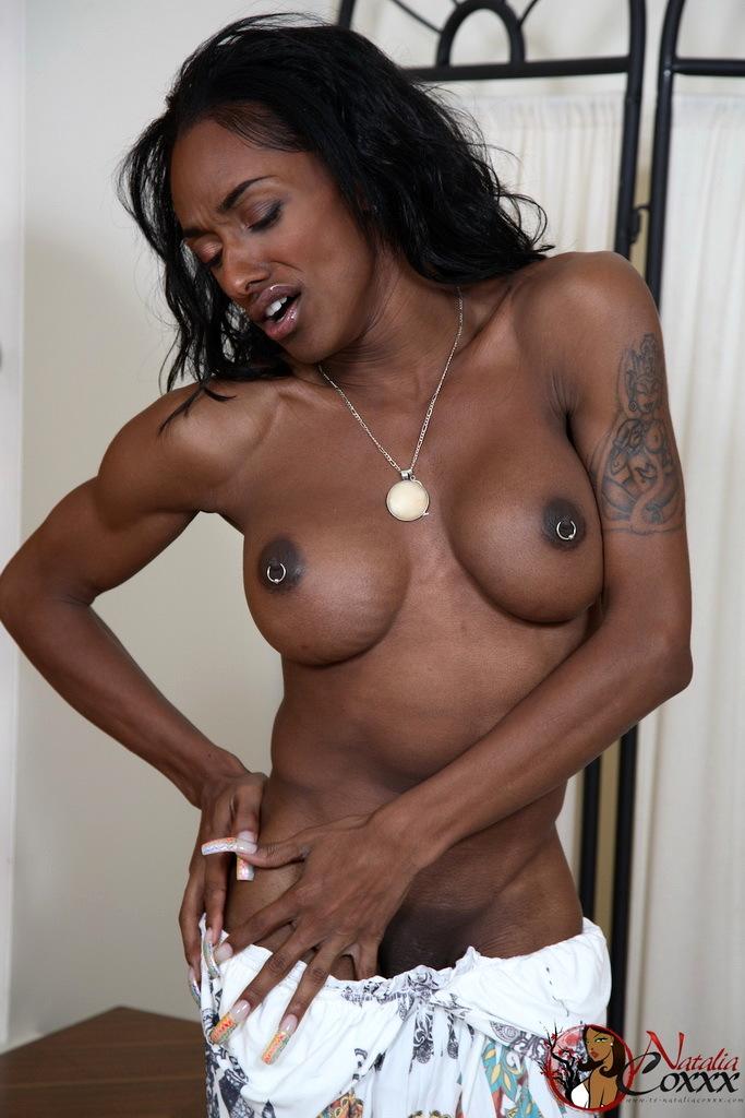 Provocative Ebony TGirl Natalia Coxxx Stripping And Teasing
