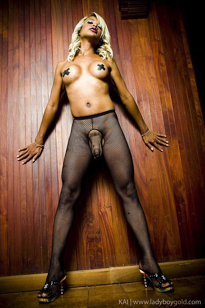 Transexual Kai Exposes Taped Nipples And Massive Hanging Balls